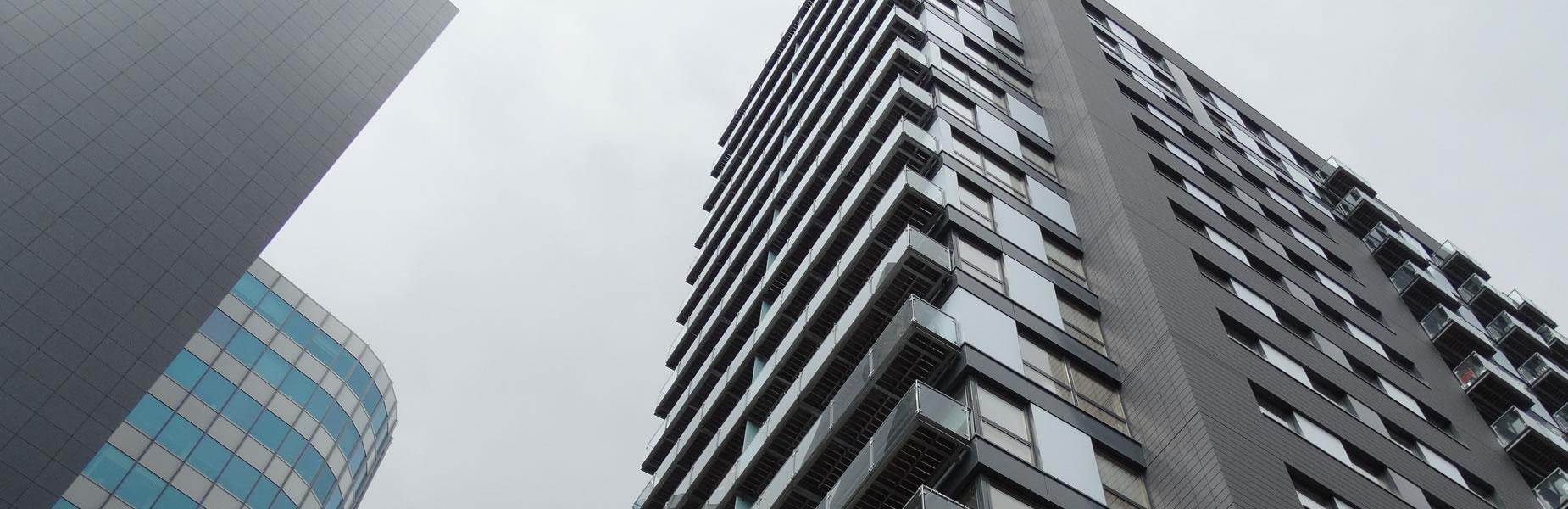 slide-1-background-large-buildings-grey-sky