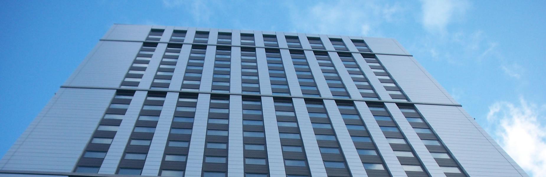 slide-2-background-large-building-blue-sky